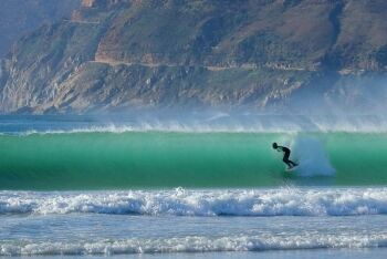 A surfer on a perfect wave, Noordhoek beach, Cape Town, Western Cape